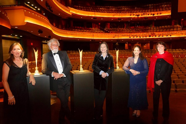 From left to right, the 2014 Dayton Literary Peace Prize winners: Margaret Wrinkle,  Bob Shacochis, Louise Erdrich, Karima Bennoune, and Jo Roberts pose with their prizes before the awards ceremony.
